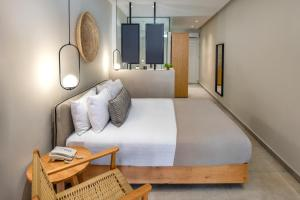 A bed or beds in a room at Callia Retreat Suites - Adults Only