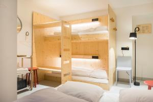 A bed or beds in a room at The Green Elephant Hostel & Spa