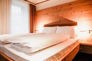 Ein Bett oder Betten in einem Zimmer der Unterkunft Gasthaus zur Waldegg; BW Signature Collection