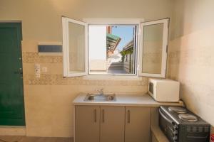A bathroom at Chandris Apartments