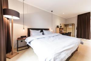 Кровать или кровати в номере cantera by Wiegand
