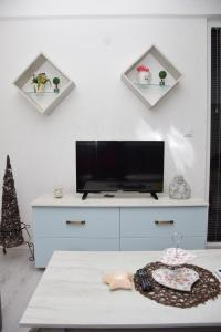 A television and/or entertainment center at Markos Towers Apartments