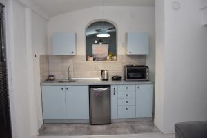 A kitchen or kitchenette at Markos Towers Apartments