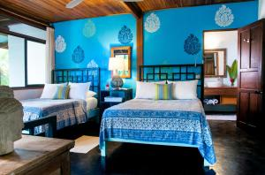 A bed or beds in a room at Blue Osa Yoga Retreat & Spa