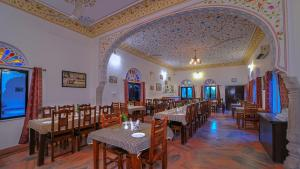 A restaurant or other place to eat at Ranthambhore Heritage Haveli