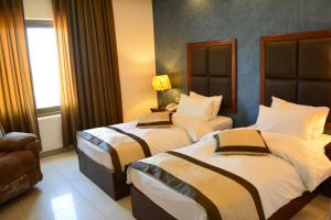 A bed or beds in a room at Tetra Tree Hotel