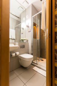 A bathroom at Arosfa Hotel London by Compass Hospitality