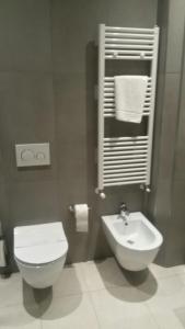 A bathroom at Gabbiano Hotel