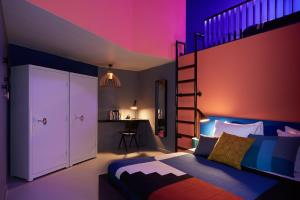 A bed or beds in a room at The Student Hotel Amsterdam City