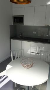 A kitchen or kitchenette at Apartmani Luce