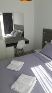 A bed or beds in a room at Apartmani Luce