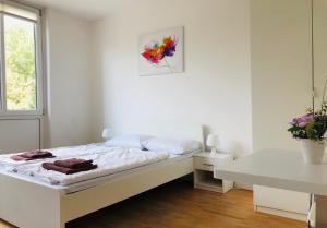 Un ou plusieurs lits dans un hébergement de l'établissement BNB Potsdamer Platz - Rooms & Apartments