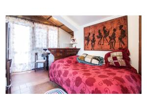 A bed or beds in a room at Le Acacie Felici