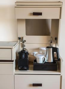 Una cocina o zona de cocina en CPH   Pevero Hotel