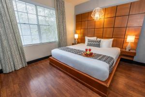 A bed or beds in a room at Chesterfield Hotel & Suites