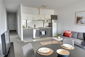 A kitchen or kitchenette at Mantra Wollongong