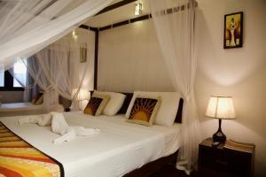 Posteľ alebo postele v izbe v ubytovaní Glamour Mirissa
