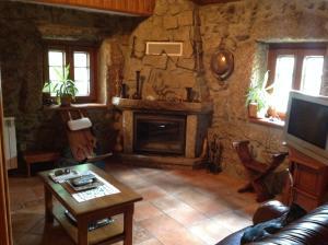 Uma área de estar em Quinta Do Circo - Serra Da Estrela - Turismo Rural