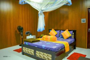 A bed or beds in a room at Will Guest Homestay