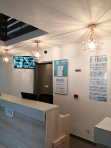 The lobby or reception area at Kyriad Direct Nantes la Beaujoire
