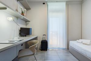 A television and/or entertainment center at Camplus Guest Bononia Casa per Ferie