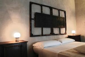 A bed or beds in a room at Tuttaterra