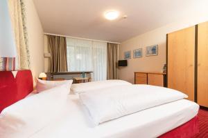 Ein Bett oder Betten in einem Zimmer der Unterkunft Morada Hotel Bad Wörishofen