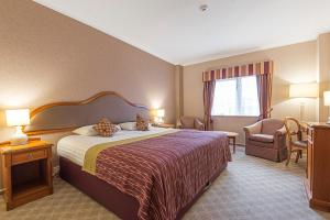 A bed or beds in a room at Coppid Beech