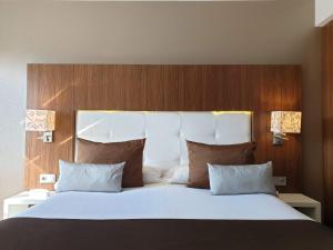 Cama o camas de una habitación en Gran Hotel Botánicos