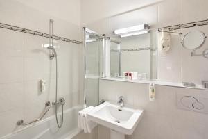 Ванная комната в Austria Trend Hotel Astoria Wien