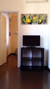 Телевизор и/или развлекательный центр в Casa Vacanze Lory