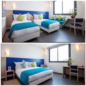 سرير أو أسرّة في غرفة في Relax Hotel Casa Voyageurs