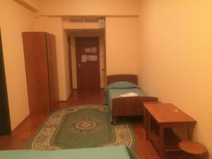 Кровать или кровати в номере Спортивно-развлекательный комплекс «Ильинка-спорт»