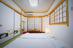 A bed or beds in a room at Kotoba Family House - 3rd floor 5 rooms
