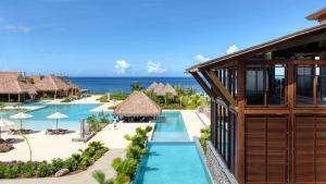 The swimming pool at or close to Cabrits Resort & Spa Kempinski Dominica