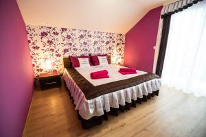 A bed or beds in a room at Holiday Home with Hot tub and Sauna Sabina