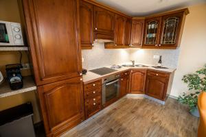 A kitchen or kitchenette at Holiday Home with Hot tub and Sauna Sabina