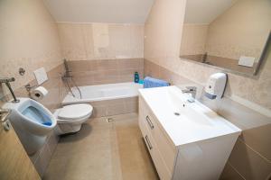 A bathroom at Holiday Home with Hot tub and Sauna Sabina
