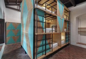 A bunk bed or bunk beds in a room at Adra Hostel