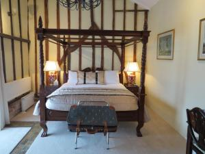 A bed or beds in a room at The Greyhound - Historic former Inn