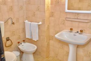 Een badkamer bij Squash Club Apartamentos