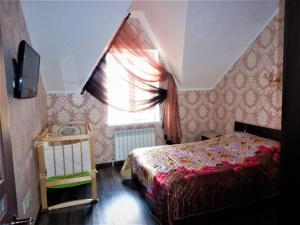 Кровать или кровати в номере Бунгало в Банном