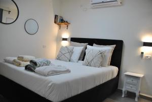 מיטה או מיטות בחדר ב-Marvin's Place