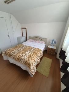 Cama ou camas em um quarto em Garibaldi Hostel e Café