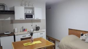 Una cocina o kitchenette en Chaltén Apart 365