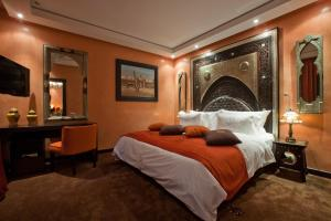 A bed or beds in a room at Art Palace Suites & Spa