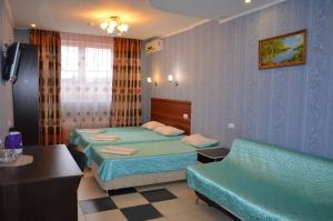 Кровать или кровати в номере Гостевой дом Флайт