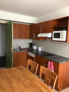 A kitchen or kitchenette at Au Soleil du Sundgau