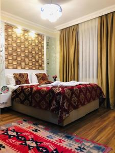 A bed or beds in a room at Art City Hotel Istanbul