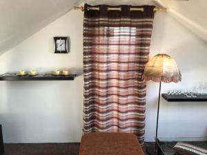 Televízia a/alebo spoločenská miestnosť v ubytovaní NRC Apartments
